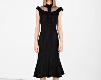 Black midi dress with handmade details