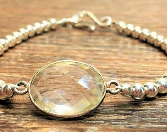 Sterling silver with crystal quartz connector