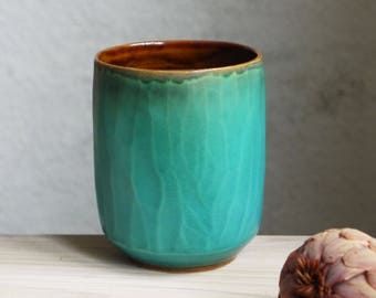 tea cup, coffee cup with a matt faceted surface, tumbler, unique pottery, designer ceramics, texture, brown and turquoise, modern ceramics