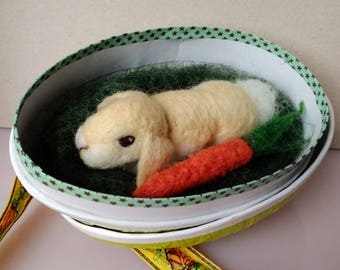 Needle-felted bunny rabbit with a carrot living in a egg