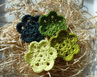 Crocheted applique, four flowers in shades of green