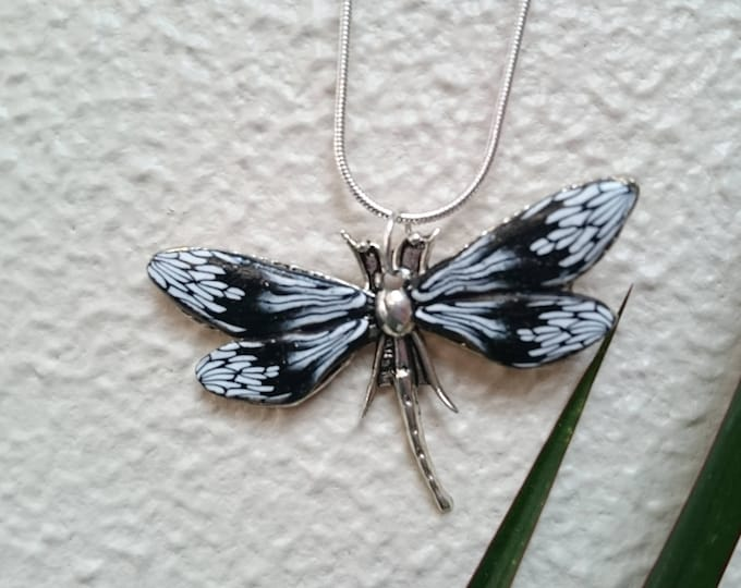 Necklace black and white dragonfly in rhinestones in polymer clay.