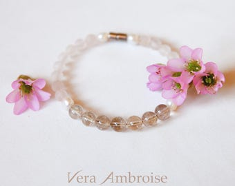Feminine gemstones bracelet with Rutilated quartz,  Rose Quartz and Sweet water Pearls. Handmade and unique!