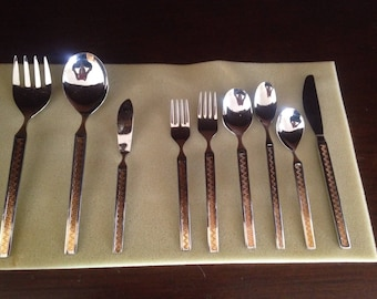 Full 12 piece set of Noritake Eros Gold Greek Key stainless cutlery in original box  (75 pieces)