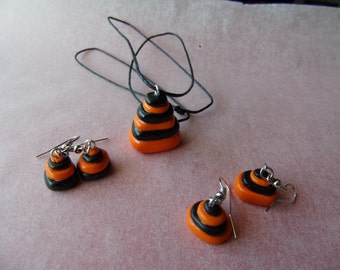 "Adornment ""Stacking orange and black"" necklace and two pairs of earrings ears"