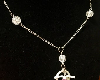 Birth control-inspired necklace on fine chain with bead detail