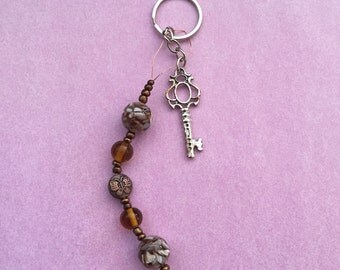 Charm - various browns and a butterfly!