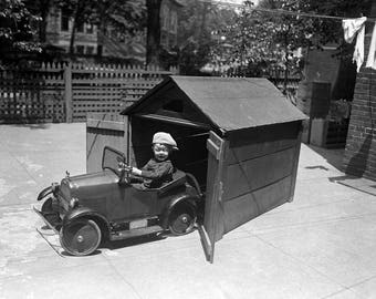 "1925 Young Boy in Pedal Car with Garage Vintage Photograph 8.5"" x 11"""