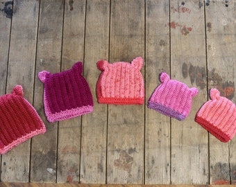 Pink pussyhats in a variety of sizes