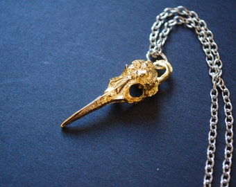 gold tone bird skullnecklace