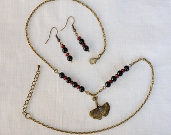 Set in Burgundy jade beads and onyx necklace and earrings
