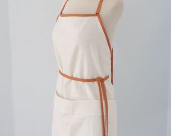 Cream and orange apron