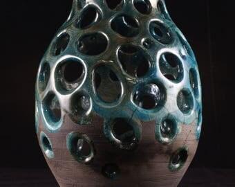 raku vessel carved