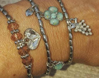 Beautiful silver bracelets with charms, fit most wrists