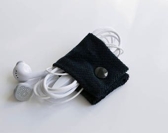 Fabric earbud holder