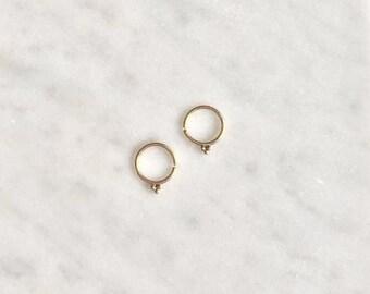 9 carat gold hoop earrings with beaded detail