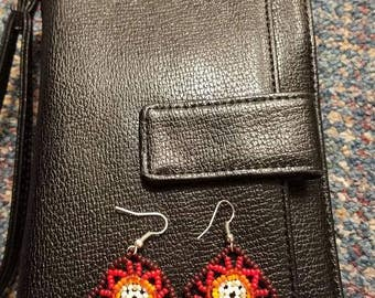 red, orange, yellow, and white beaded earrings