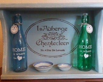 Shabby Chic duck egg blue shelving with French stenciled top
