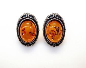 Sterling Silver Oval Cut Amber Stud Earrings