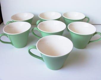 1950's  7 porcelain  cups  (#EV80)
