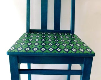 Teal blue wooden chair with funky, retro diamond design decoupaged seat