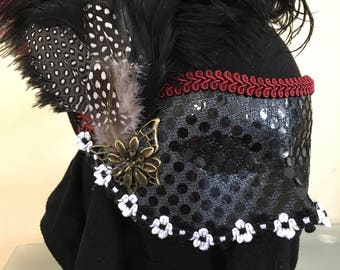 Masquerade mask, black red and white.