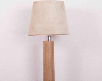Rustic wooden lamp base of eucalyptus, cowhide lamp shade beige