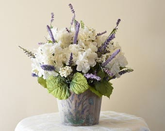 Ivory and Purple Flower Arrangement in a Hand-Painted Rustic Wooden Barrel