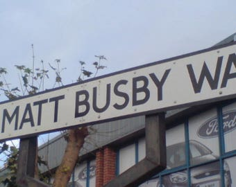 Sir Matt Busby Way road sign.