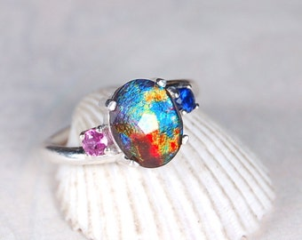 "Ammolite ring.""Candles Behind a Church Stained Glass Window"".Natural Sapphires."