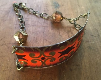 Orange filagree cuff bracelet