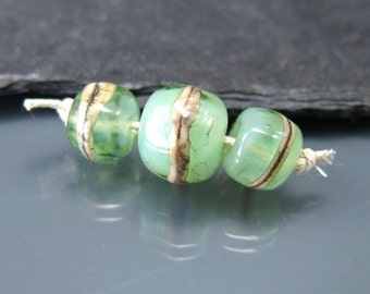 Handmade Lampwork Nugget Beads by GlassBeadArt …  Focal  2 accent beads set Light opal green and  silvered ivory  ... SRA F12 .
