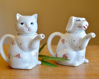 Set of two vintage ceramic hand painted cat and dog teapots or creamers. 1950s serveware