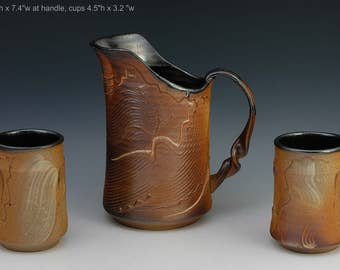 Stonewa pitcher and cups, pouring slip decorated wood fired p31