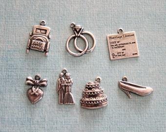 7 Silver Wedding Charms 2410