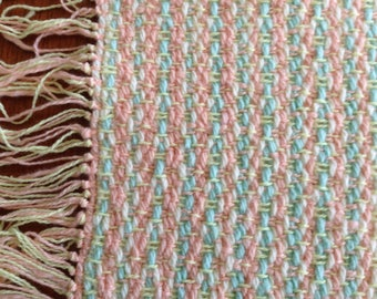 Handwoven table runner in sherbet cotton