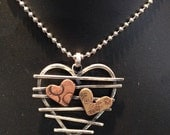 Industrial Sterling silver wire heart with small copper and brass hearts