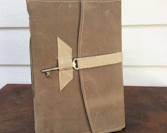 LG taupe leather journal / sketchbook with handmade cotton rag paper. Closes with an antique skeleton key.