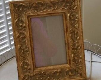 Small table top gilt frame