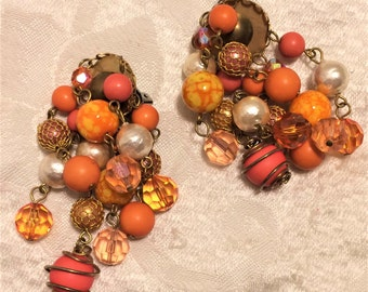 Vintage Dangle Bead Clip On Earrings with Orange, Pink, Yellow, Faux Pearl Beads. Some Beads are Caged, Some Netted. They Are 3 Inches (D8)