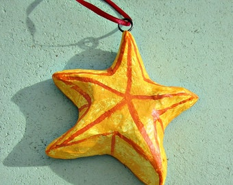 Ornament, Yellow Handmade Paper Mache Star with Red Ribbon