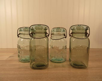 Two Vintage aqua blue green glass canning jars and 2 pale green canning jars with lids, mason jars, canning supplies