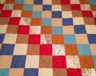 "Sale was 99.00 now 89.00   Quilt, 43""x66"", lap size quilt, machine quilted, red, blue, teals, browns, patchwork quilt"