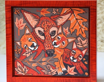 Red wolf woodcut framed in solid tiger maple wood allow 4 weeks for delivery