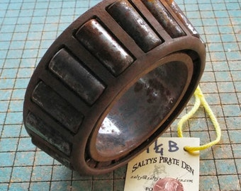 "Big rusty Bearing, industrial paperweight, doorstop, Tapered Roller Bearing, great for found art metal sculpture, 4 1/4""B"