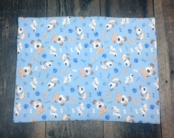 blue and brown puppy dogs  hand quilted pet food mat or anything you could find it useful for