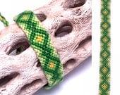 Friendship bracelet - embroidery floss - diamond pattern - green - yellow - handmade - macrame - woven - string - thread