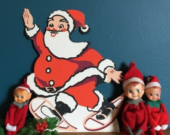 """Vintage Christmas Decoration / Standing 12"""" Cardboard Santa with Easel Back / Retro Style St. Nick Waving Wearing Snow Shoes"""