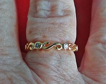 Delicate Vintage gold tone band ring w rhinestones in great condition, appears unworn  Sizes available 5, 6, 7, 8, 9, 10