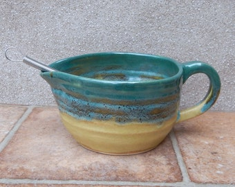 Batter mixing and pouring bowl sauce or gravy jug or pitcher wheelthrown stoneware with a whisk ceramic pottery handmade handthrown